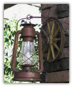 A A Old Time Wagon Wheel Sconce With Lantern