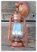 A Old Time Rustic Oil Lantern Electric Wall Sconce